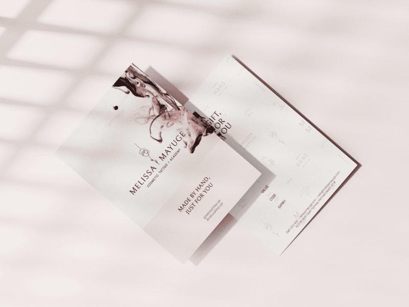 Photo of gift voucher with shadow on pink background